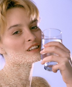 Woman with dry mouth holding a glass of water
